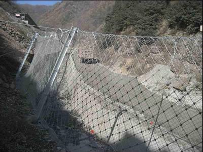 Steel wire rope net is installed besides of the road.