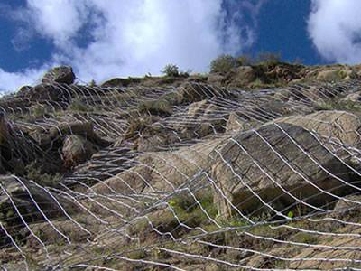 Spider spiral rope mesh system is protecting the mountain.