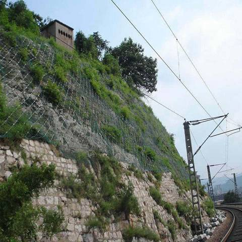 Galvanized steel wire rope is covering the mountain besides of the railway.