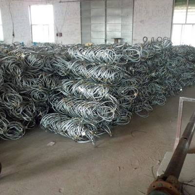 Several rolls of steel wire rope net in the warehouse.